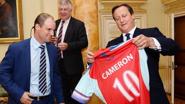David Cameron is presented a No. 10 jersey by Andrew Strauss at 10 Downing Street