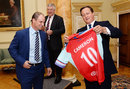 David Cameron is presented a No. 10 jersey by Andrew Strauss at 10 Downing Street, London, September 10, 2015