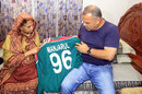 Zimbabwe coach Dav Whatmore meets the mother of the late Manzarul Islam, Khulna, January 21, 2016