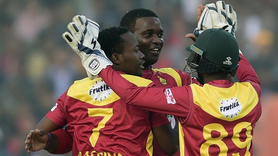 Tendai Chisoro and Neville Madziva celebrate a wicket