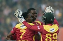 Tendai Chisoro and Neville Madziva celebrate a wicket, Bangladesh v Zimbabwe, 4th T20I, Khulna, January 22, 2016