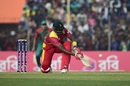 Hamilton Masakadza plays a sweep, Bangladesh v Zimbabwe, 4th T20I, Khulna, January 22, 2016