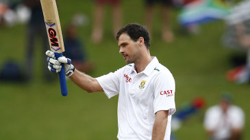 Stephen Cook takes in the applause for his century