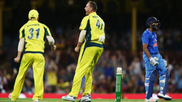 John Hastings lets out a cry after removing Rohit Sharma for 99