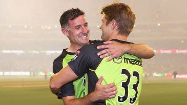 The departing Michael Hussey is embraced by Shane Watson