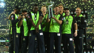 The Sydney Thunder players get together after sealing the title