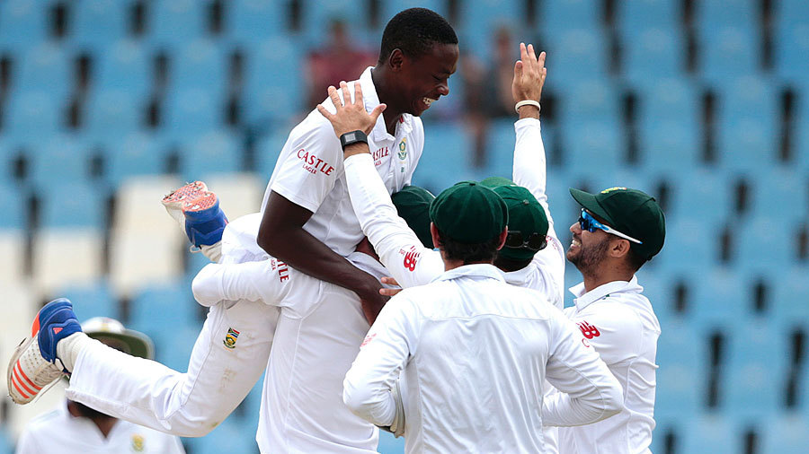 Kagiso Rabada gets hoisted by his team-mates after another wicket