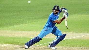 Virat Kohli punches the ball through cover