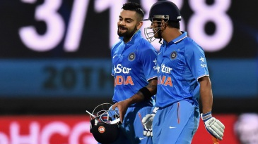 Virat Kohli and MS Dhoni walk off after taking India to 3 for 188