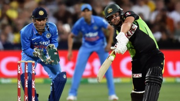 Aaron Finch shapes for a big hit