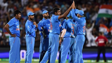 R Ashwin is mobbed by his team-mates