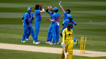 Jhulan Goswami celebrates a wicket with her team-mates