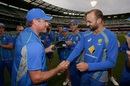 Nathan Lyon is handed his Australia T20I cap by Ryan Harris, Australia v India, 2nd T20I, Melbourne, January 29, 2016