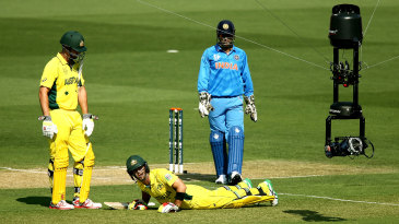 The Spidercam is visible as Glenn Maxwell reacts after getting cramps