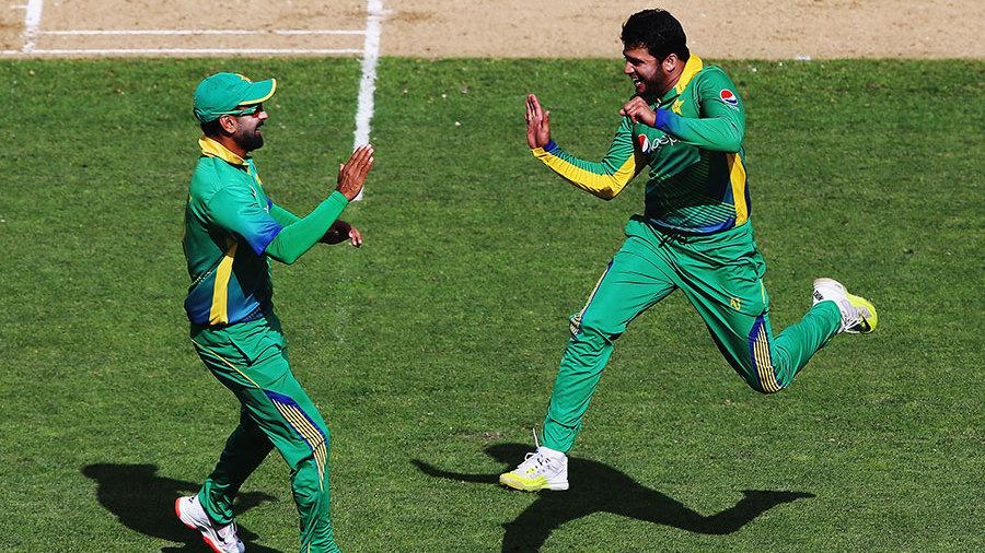 Azhar Ali celebrates with Ahmed Shehzad
