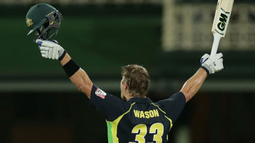 Shane Watson celebrates after scoring the first T20I hundred in Australia