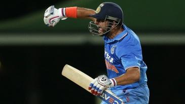 Suresh Raina punches the air after hitting the winning runs