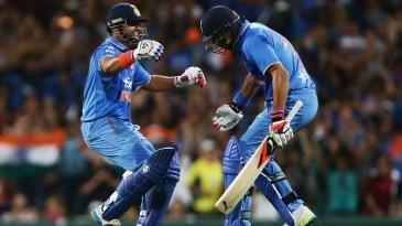 Suresh Raina celebrates India's win with Yuvraj Singh