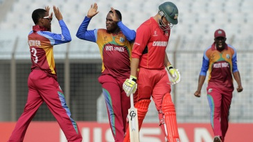 Gidron Pope celebrates a wicket with captain Shimron Hetmyer