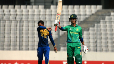 Hasan Mohsin raises his bat after scoring his first fifty of the tournament