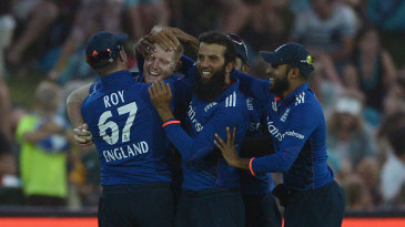 Ben Stokes is mobbed by his team-mates after a stunning catch to dismiss AB de Villiers