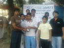 Saif Hassan (centre) receives a trophy at the Dhanmondi Cricket Academy, 2009