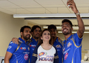 Rohit Sharma, Jasprit Bumrah and Hardik Pandya pose with Nita and Akash Ambani, the owners of the Mumbai Indians franchise, Mumbai, February 5, 2016
