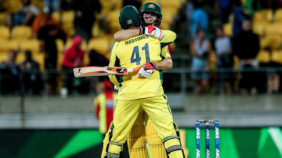 Mitchell Marsh and John Hastings embrace after Australia's win