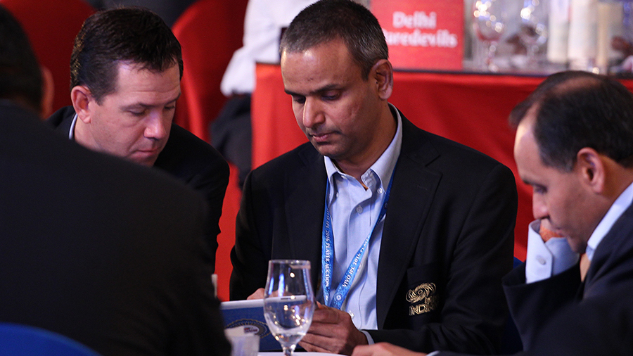 Mumbai Indians coach Ricky Ponting and Sundar Raman, CEO (sports) of Reliance chat at the player auction