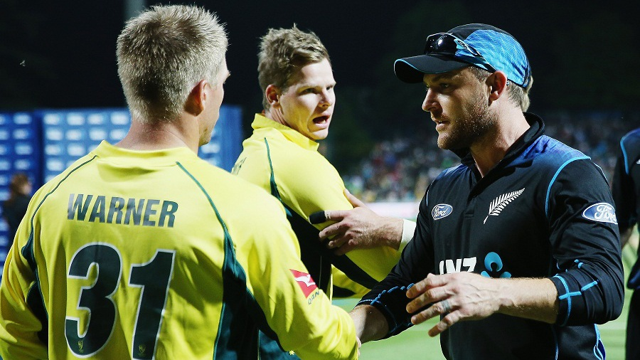 Brendon McCullum is congratulated by Steven Smith and David Warner