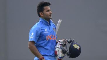 Rishabh Pant walks back after being dismissed