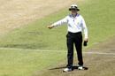 Umpire Sam Nogajski signals a four, Western Australia v Tasmania, day two, Perth, November 1, 2014