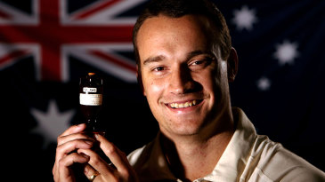 Stuart Clark poses with the Ashes urn