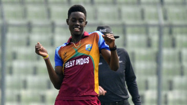 Shamar Springer celebrates a wicket with his signature dance moves