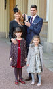 James Anderson at Buckingham Palace, with wife Danielle, and daughters Lola and Ruby, after receiving his OBE, London, February 11, 2016