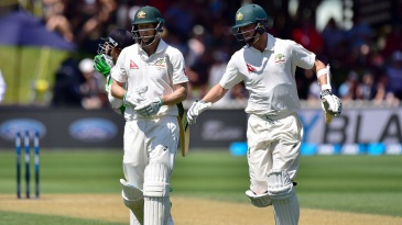 Adam Voges and Jackson Bird walk back after taking Australia to 562