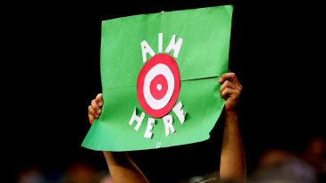 A fan holds up a sign reading: