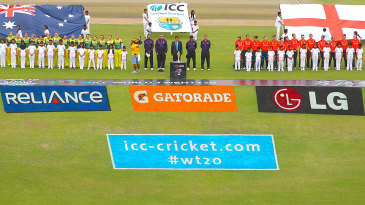 The England and Australia teams line up for the national anthems