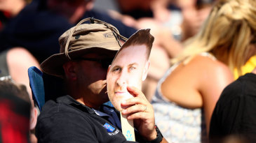A fan catches the action from behind a Brendon McCullum mask