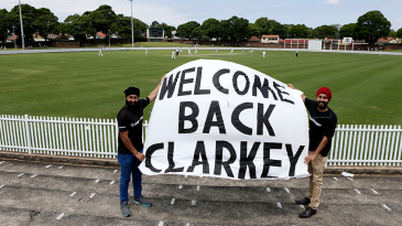 Fans hold up a banner on Michael Clarke's return to grade cricket