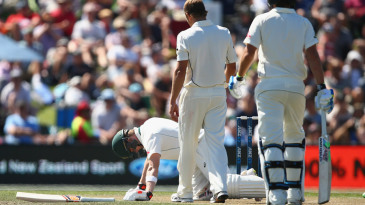 Steven Smith falls to the ground after being hit on his helmet