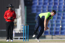 Tim Murtagh bowls as Umpire Rabiul Hoque watches