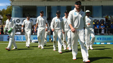 Brendon McCullum leads the New Zealand team on to the field for the last time