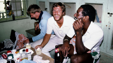 Ian Botham and Viv Richards enjoy a drink or two in the dressing room after the Test