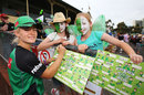 Katie Mack of Melbourne Stars signs autographs for young fans, Women's Big Bash League, Melbourne, December 5, 2015