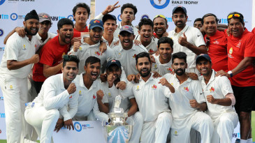 The Mumbai players pose with the Ranji Trophy