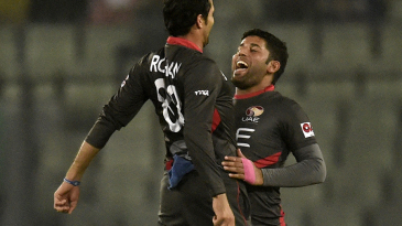 Rohan Mustafa and Mohammad Naveed bump chests to celebrate a wicket