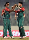 Mustafizur Rahman celebrates one of his two wickets with Nurul Hasan, Bangladesh v UAE, Asia Cup 2016, Mirpur, February 26, 2016