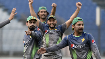 Members of the Pakistan team gesticulate during a game of soccer