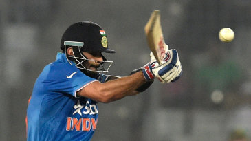 Virat Kohli pulls during his 51-ball 49
